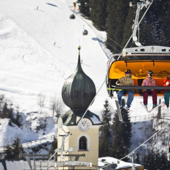 Saalbach - skiers on chair lift