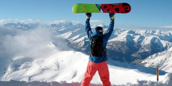 Snowboarder celebrating the view